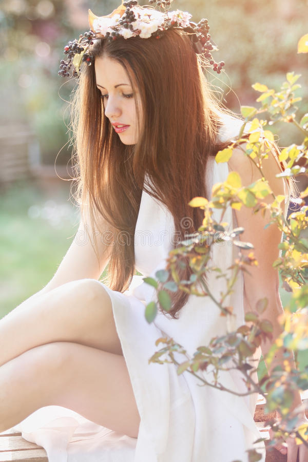 Beautiful young woman in soft spring light stock image