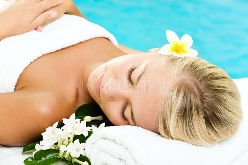 Beautiful young woman in spa royalty free stock image