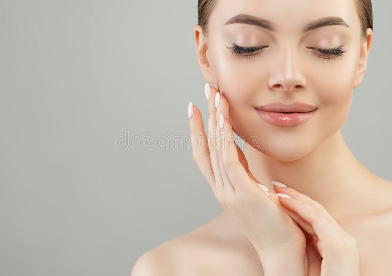 Beautiful young woman spa model. Perfect candid girl with healthy skin. Facial treatment, face lifting and skincare concept stock photo