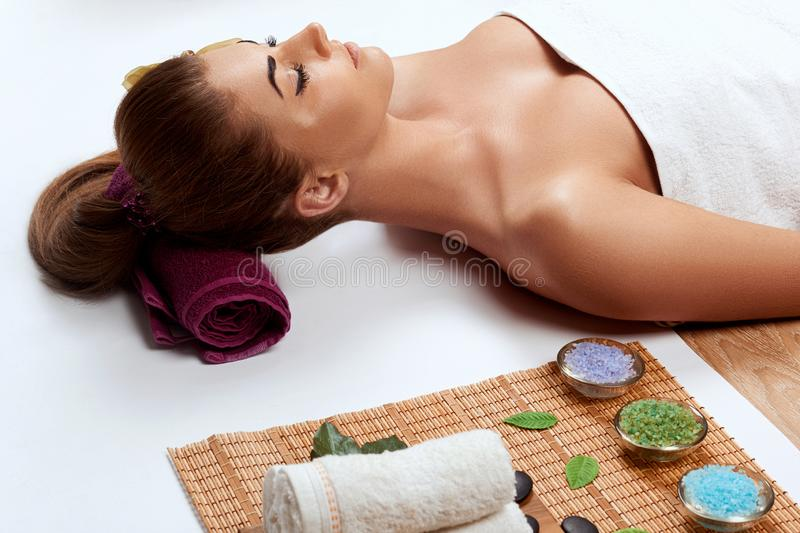 Beautiful young woman in spa salon. Face Massage Female.Facial treatment. Cosmetology. Body care stock photography