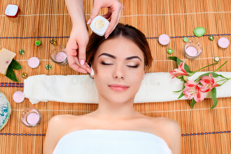 Beautiful young woman at a spa salon stock photography