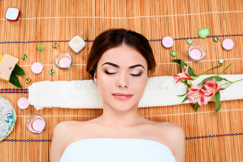 Beautiful young woman at a spa salon royalty free stock images