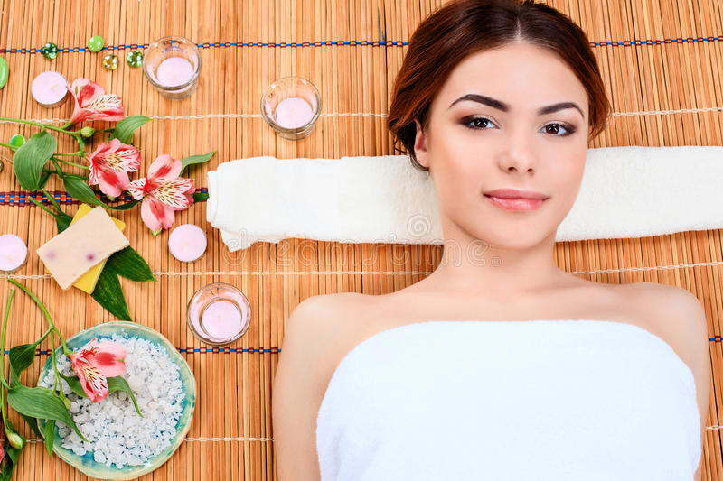 Beautiful young woman at a spa salon royalty free stock image