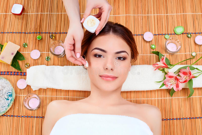 Beautiful young woman at a spa salon royalty free stock photos