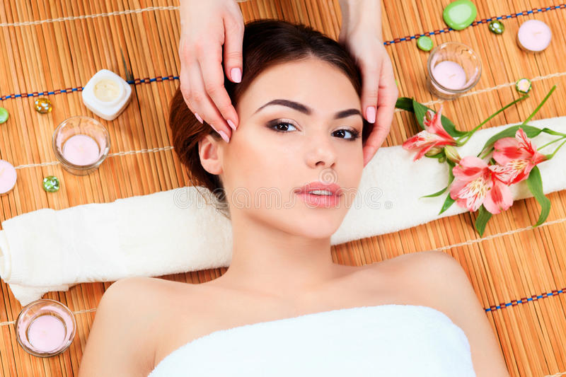 Beautiful young woman at a spa salon stock images