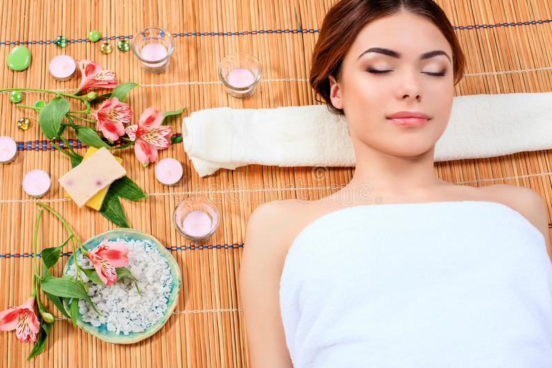 Beautiful young woman at a spa salon stock photography