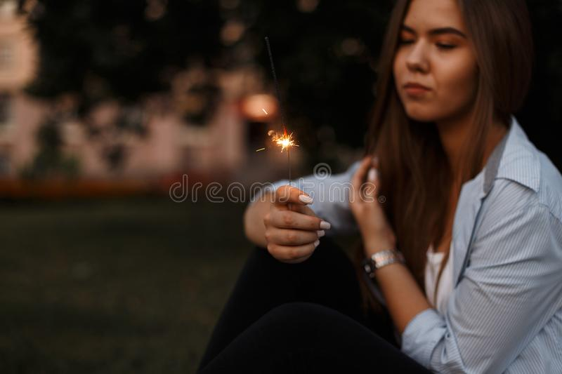 Beautiful young woman with sparkler resting on vacation royalty free stock image