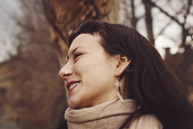 Beautiful young woman with spiritual earrings stock photography