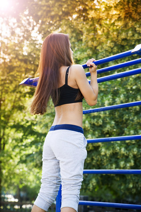 Beautiful young woman on the sports ground royalty free stock photos