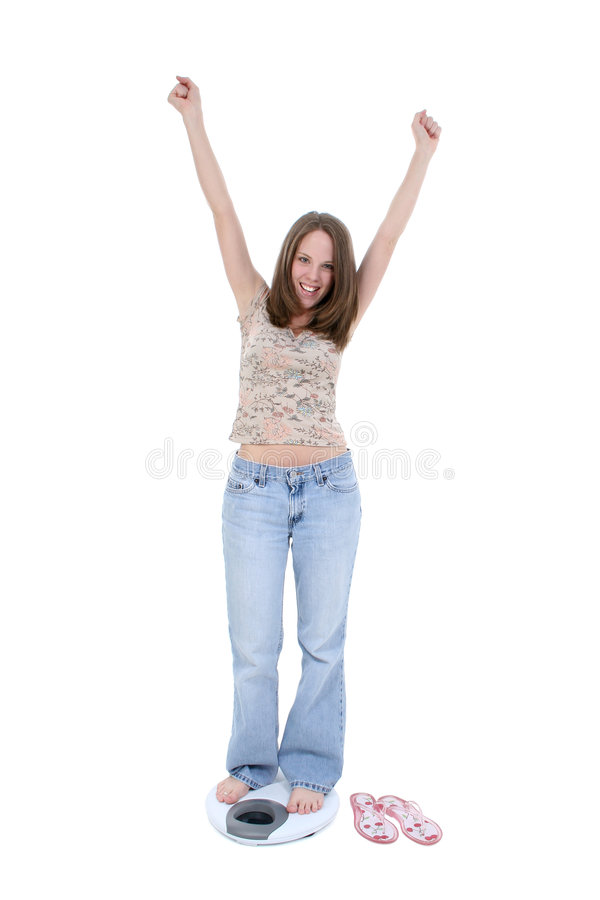 Beautiful Young Woman Standing On Bathroom Scale stock photo