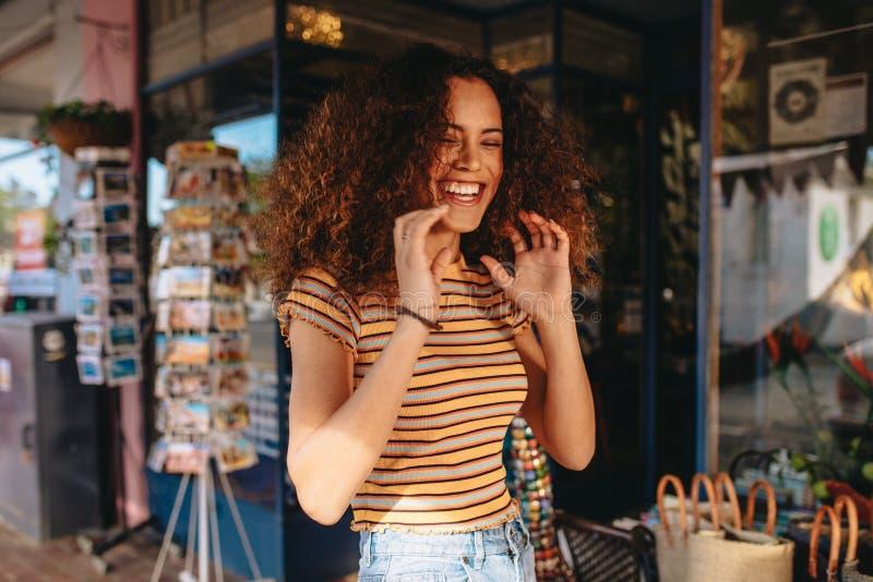 Cheerful curly hair girl stock photo