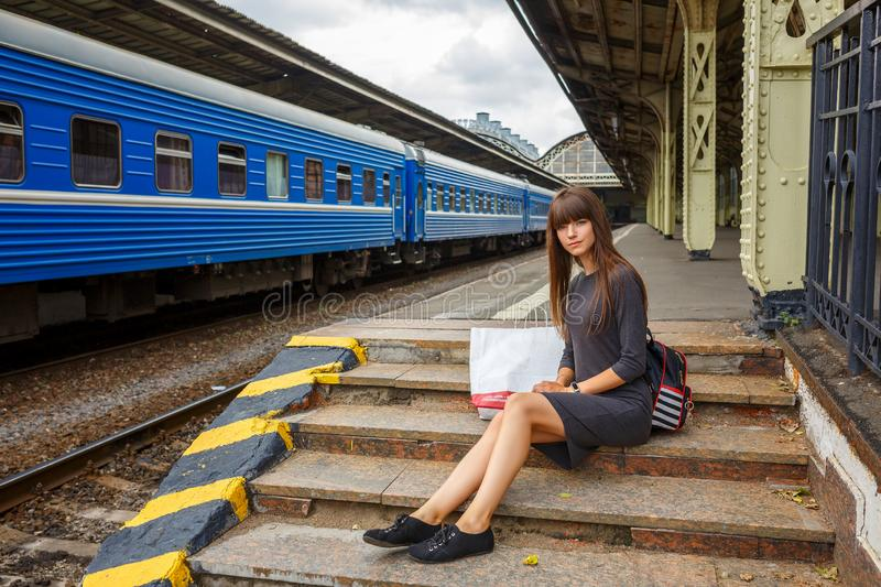 Beautiful young woman standing on the platform of railway station travel concept.  stock images
