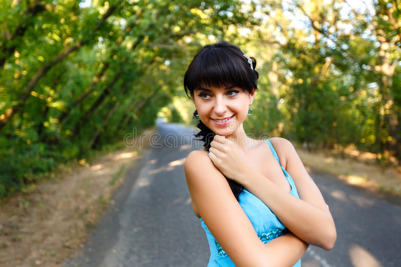 Beautiful young woman standing on road royalty free stock photo