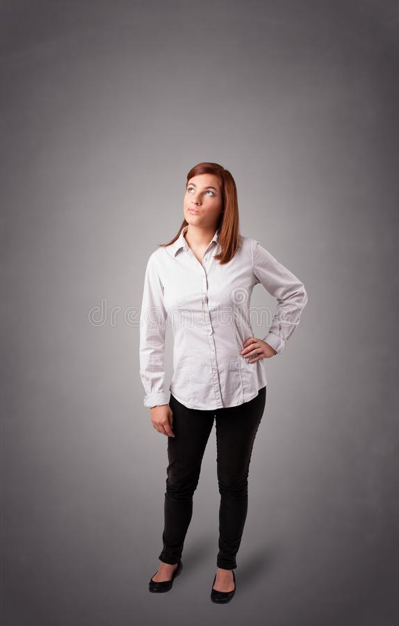 Young woman standing and thinking with copy space. Beautiful young woman standing and thinking with copy space stock images