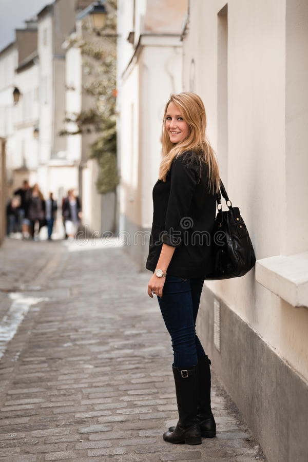 Beautiful Young Woman on Street in Paris stock image