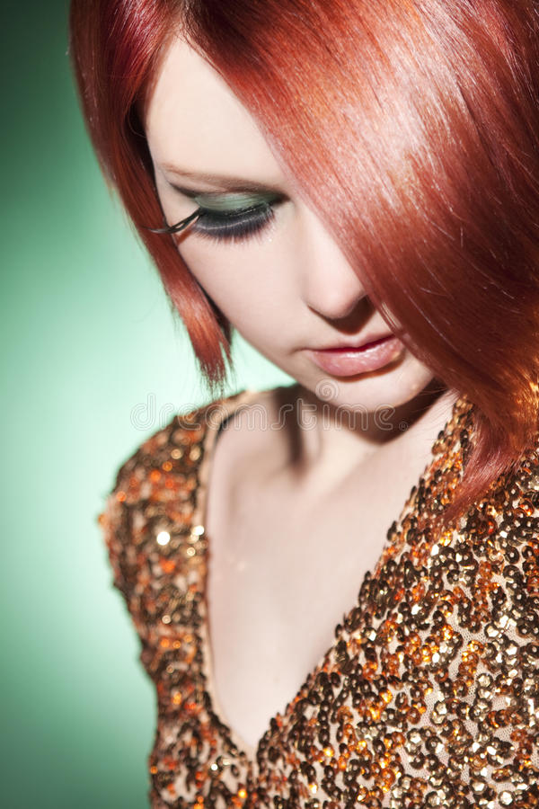 Beautiful young woman. With strong, heathy red hair stock image