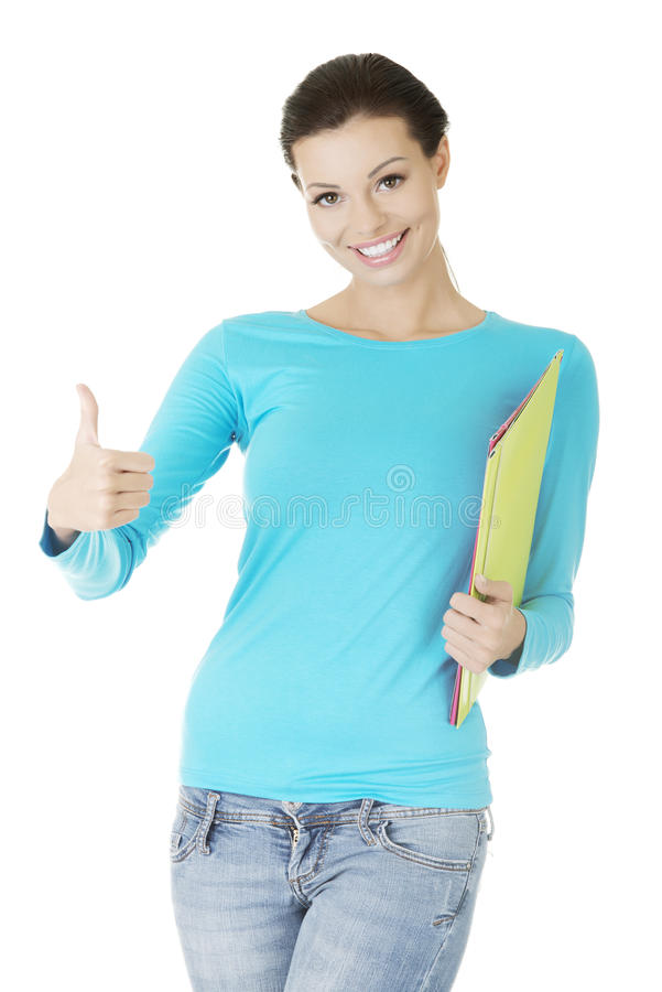 Download Beautiful Young Woman Student Gesturing Ok. Stock Photo - Image: 27983486
