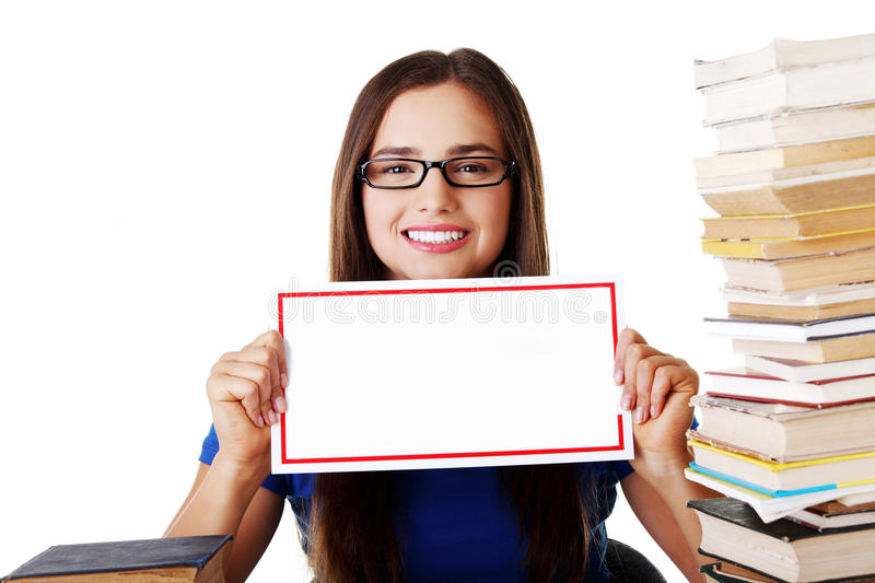 Download Beautiful Young Woman Stuydent Wih Stack Of Books And Holding Co Stock Photo - Image: 36540974