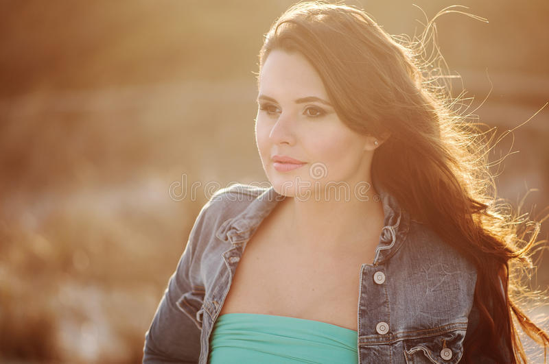 Beautiful young woman on the sunset beach royalty free stock photos