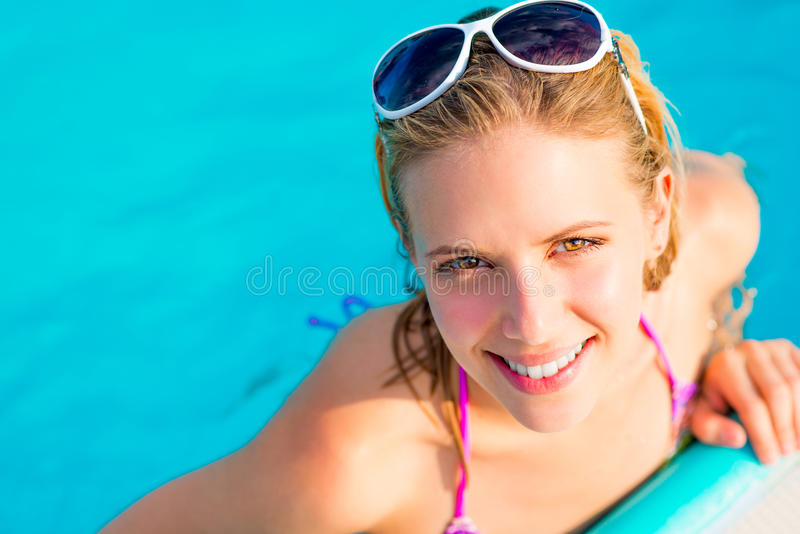 Beautiful young woman in the swimming pool royalty free stock photography