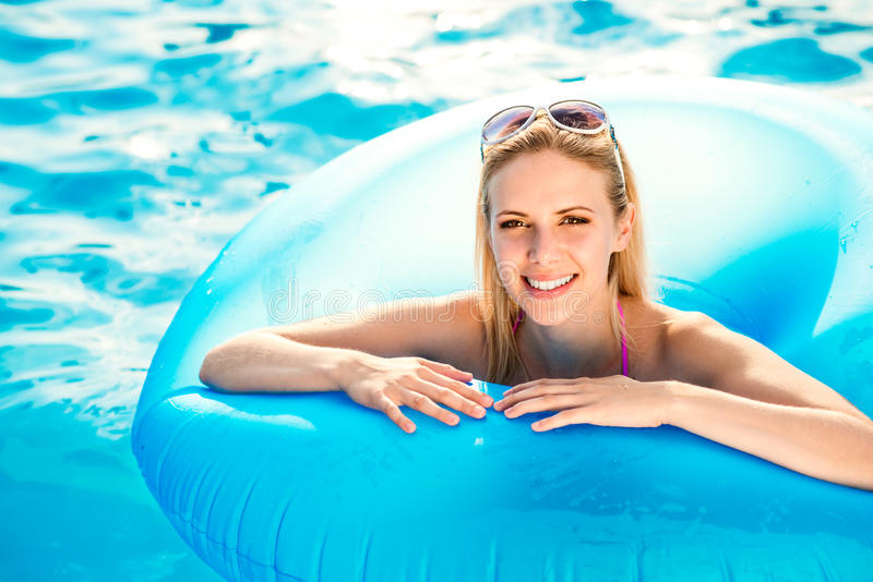 Beautiful young woman in the swimming pool stock photos