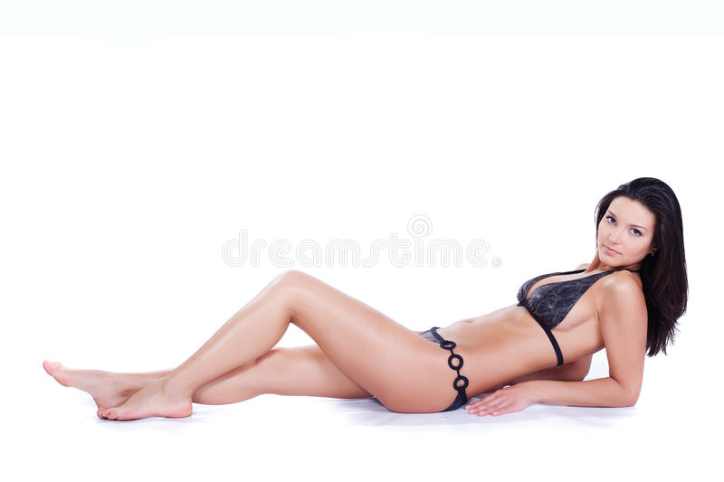 Beautiful young woman in swimwear royalty free stock images