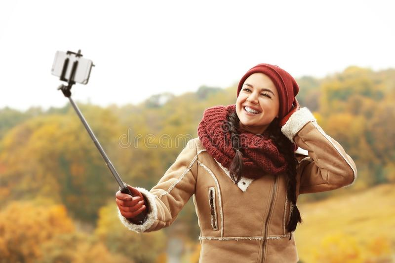 Beautiful young woman taking photos stock images