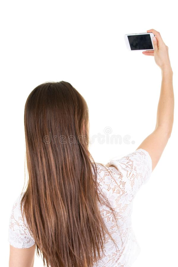 Beautiful young woman taking selfie on white background. A Beautiful young woman taking selfie on white background royalty free stock photos
