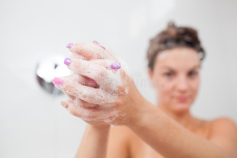 Beautiful young woman taking a shower royalty free stock images