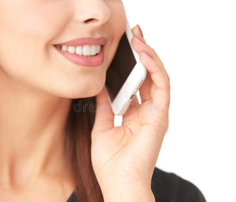 Beautiful young woman talking by mobile phone, royalty free stock image