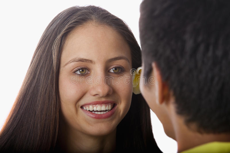 Beautiful young woman talking to a man stock photography