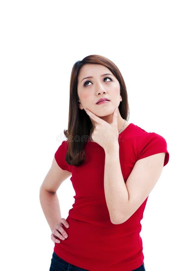 Beautiful young woman thinking stock photos