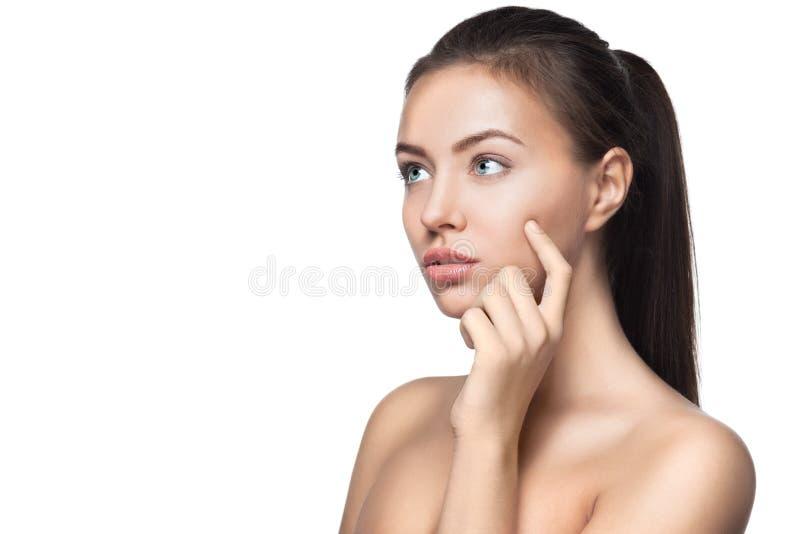 Beautiful young woman thinking stock photo