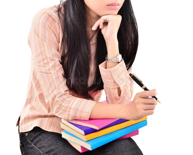Download Beautiful Young Woman Thinking On The Pile Of Books Stock Photo - Image: 34052240