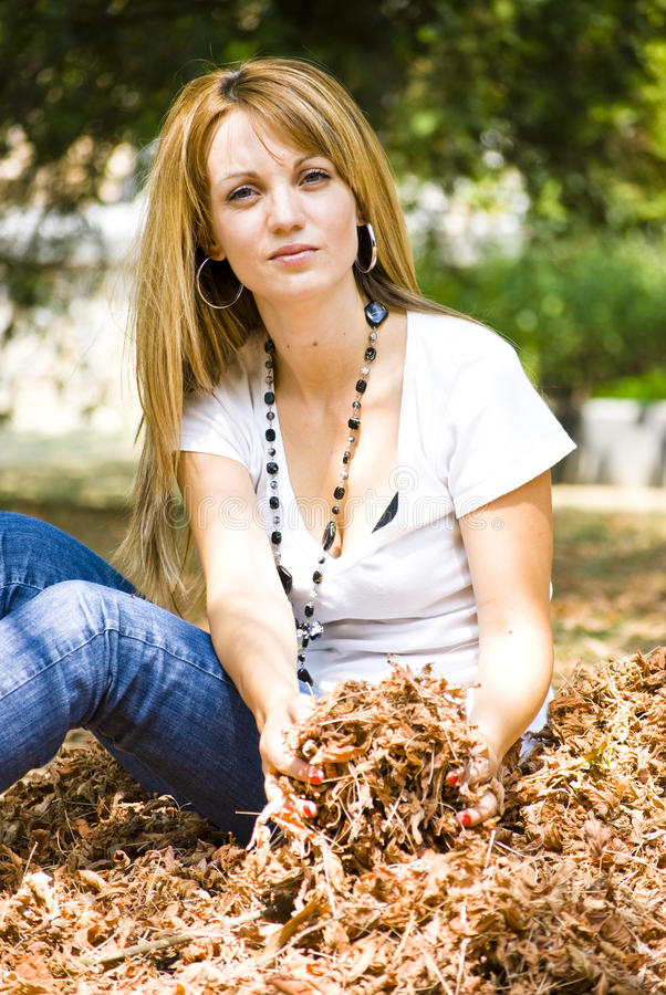 Download Beautiful Young Woman Throwing Leaves Stock Photo - Image of nature, emotion: 10654430