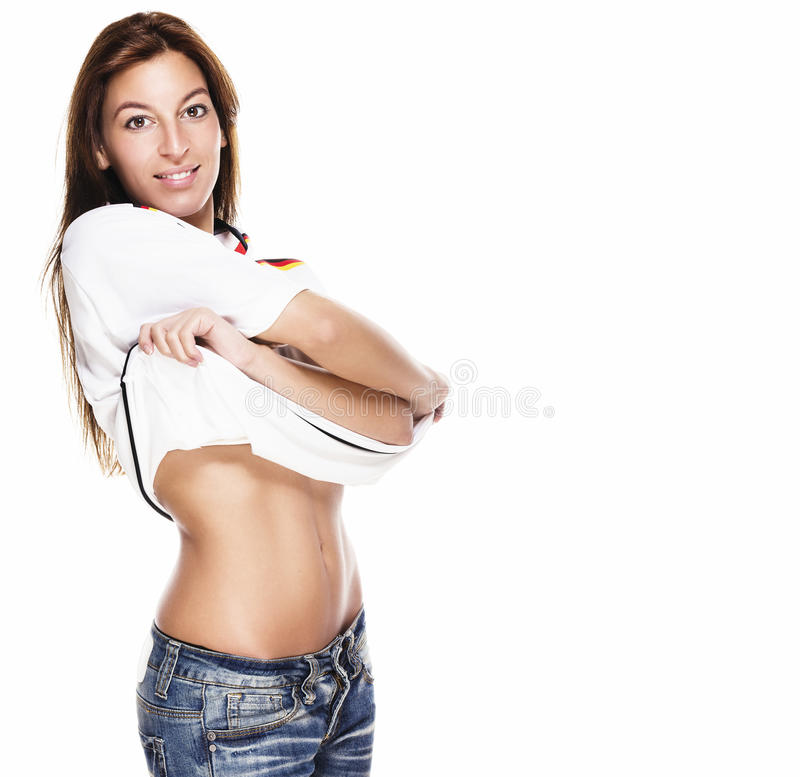 Beautiful young woman about to take her football s stock image