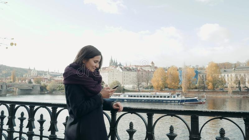 Beautiful Young Woman Tourist In Prague Using Her Smartphone, Travelling Concept royalty free stock photo