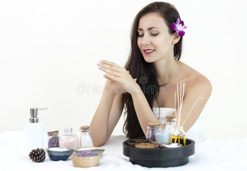 Beautiful young woman with treatment scrub relaxing in the spa salon stock photo