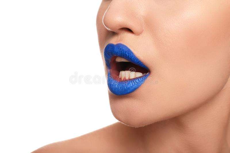 Beautiful young woman with unusual lipstick on white background, closeup royalty free stock images