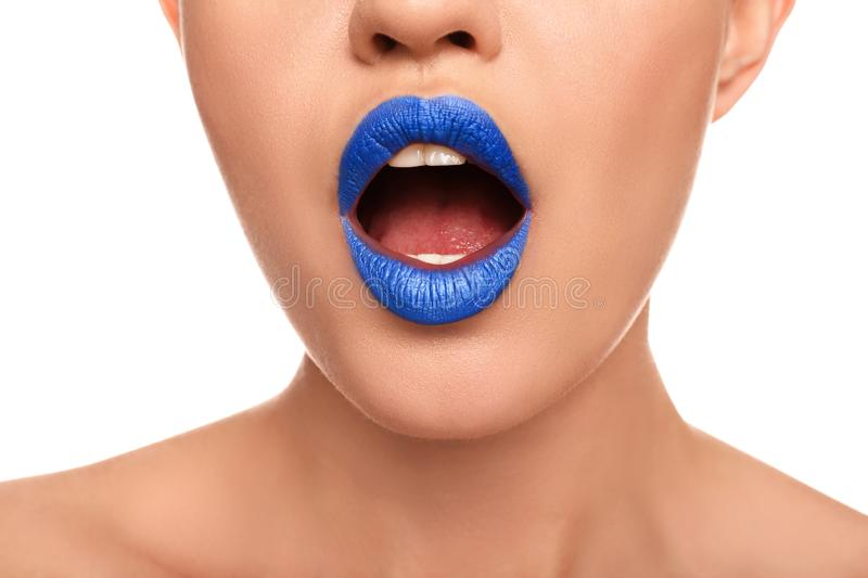 Beautiful young woman with unusual lipstick on white background, closeup royalty free stock photography