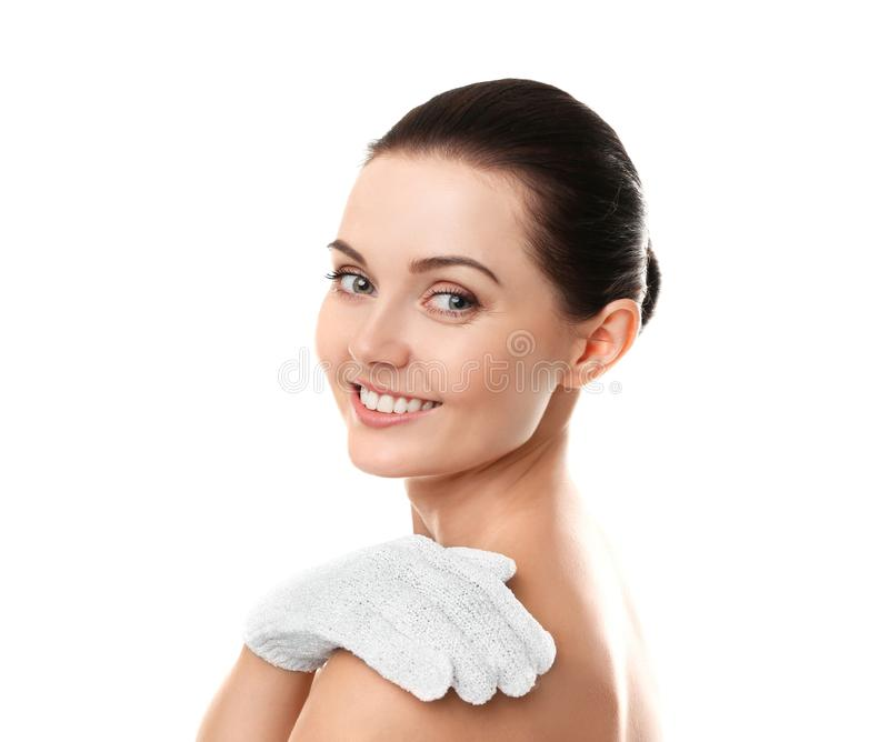 Beautiful young woman using exfoliating massage glove royalty free stock images