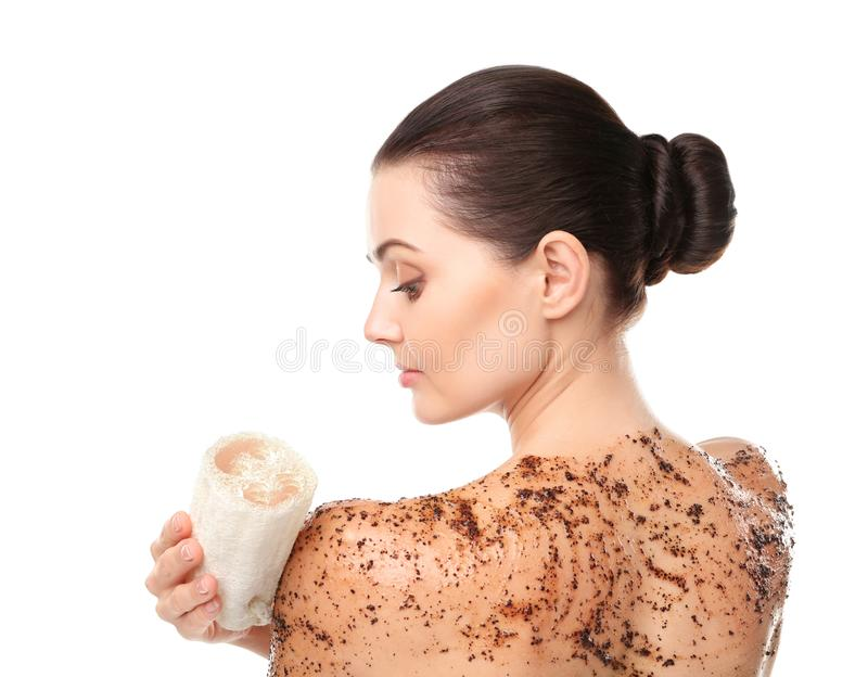 Beautiful young woman using wisp and scrub. On white background royalty free stock image