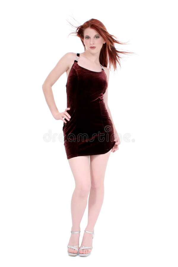 Beautiful Young Woman In Velvet Dress. And Silver Heals Over White. Shot in studio with the Canon 20D royalty free stock image