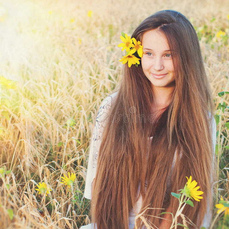 Beautiful Young Woman with very Long Hair Outdoors. royalty free stock photos