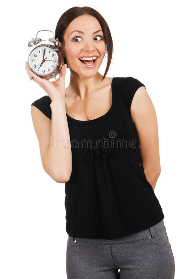 Beautiful young woman with vintage alarm clock stock photography