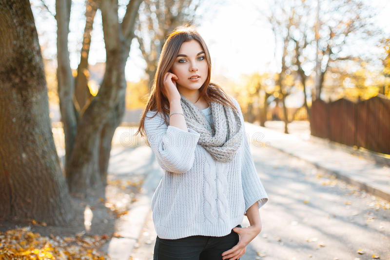 Beautiful young woman in vintage knitted sweater on the background of autumn park royalty free stock photos