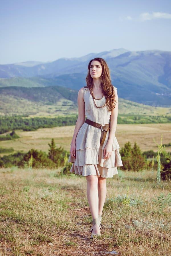 Beautiful young woman walking stock images