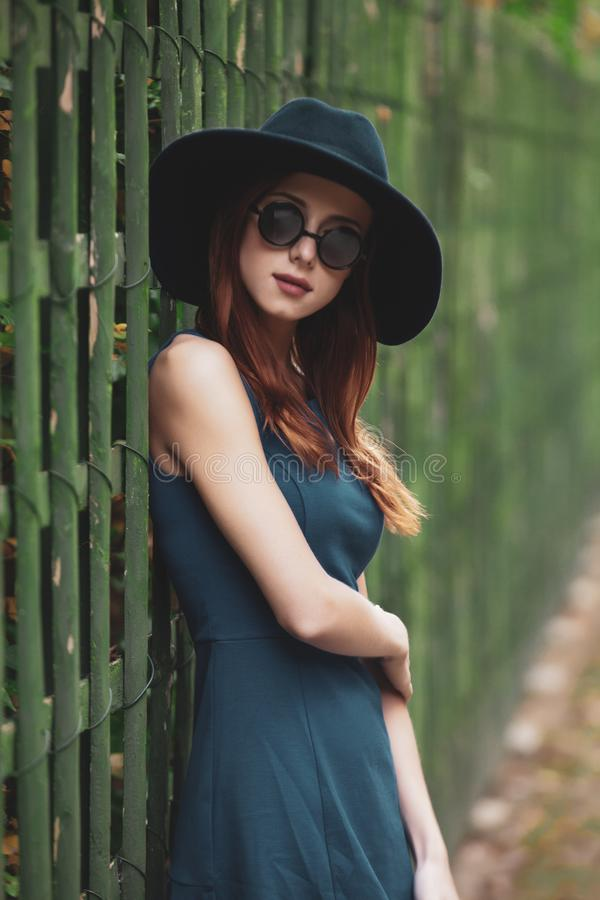 Young woman walking in the park, versailles stock photo