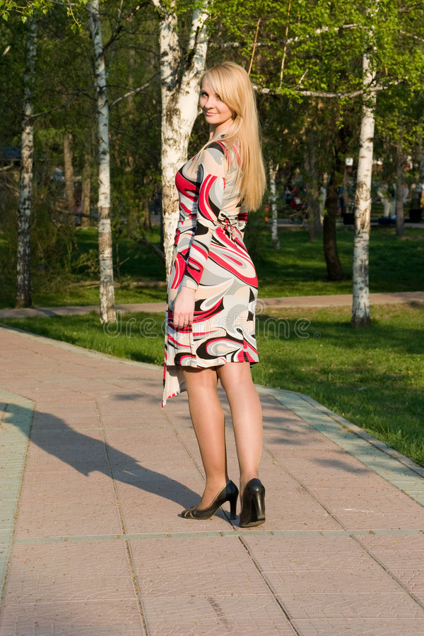Download The Beautiful Young Woman Walks On Park. Stock Image - Image: 5212451