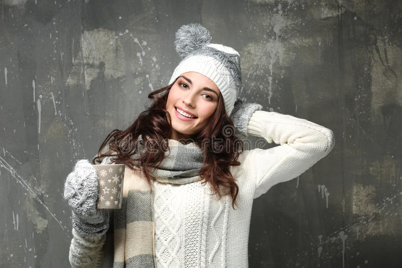 Beautiful young woman in warm clothes royalty free stock photo
